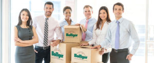 Group of business people moving office