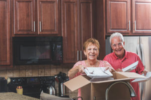Senior couple moving house in the kitchen