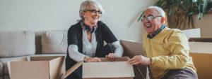 Senior couple unpacking cardboard boxes