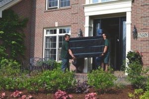 Century Movers lifting furniture