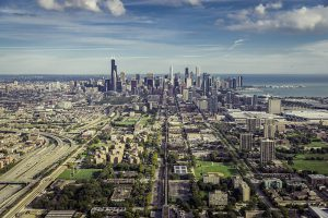 Aerial view through Chicago Downtown with suburbs