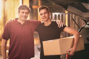 dad and son with box